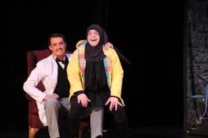 Igor sitting on Dr. Frankenstein's lap.
